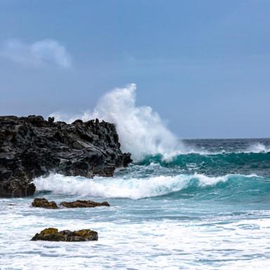 Waves crashing on volcanic rock, Maui