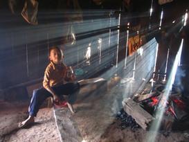 Lao boy in a hut
