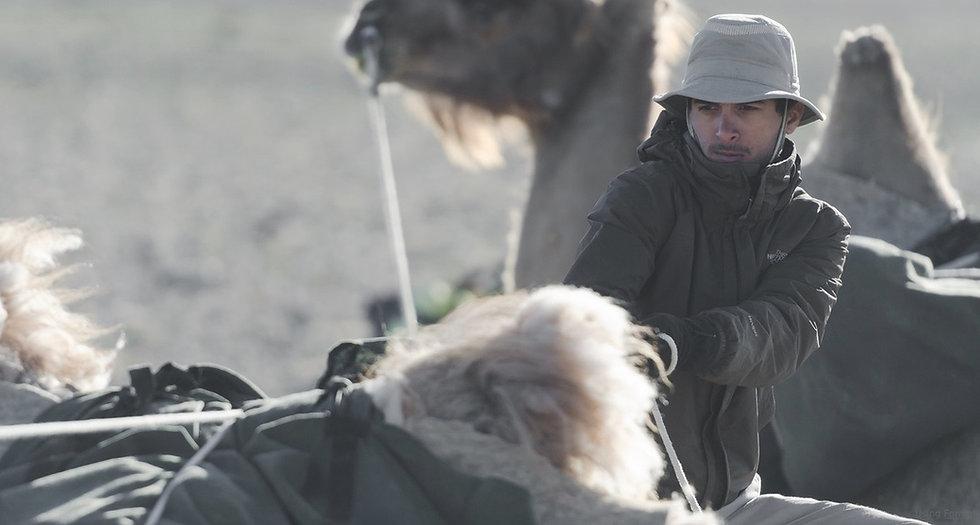 faraz-shibli-adventurer-loading-camel.jp