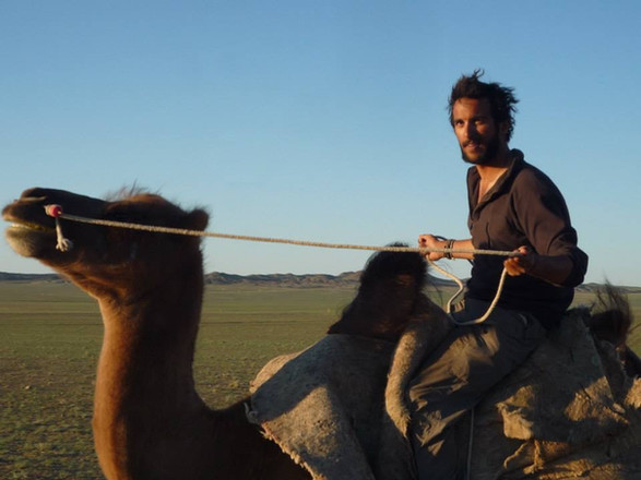 Riding a Bactrian camel