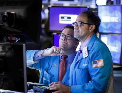 Wall Street cierra en alza tras anuncio de ayudas de la Fed
