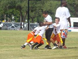 Flag kids attacking Pee-Wee Tyrese.jpg
