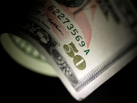 Dollar Edges Higher; Fed Meeting in Focus