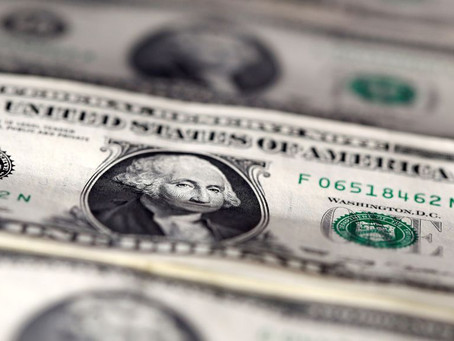 Dollar retreats again in Asia as solid data offsets virus worries.