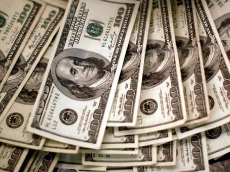 Dollar bides time below two-month highs before payrolls test