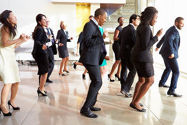 Businessmen And Businesswomen Dancing In