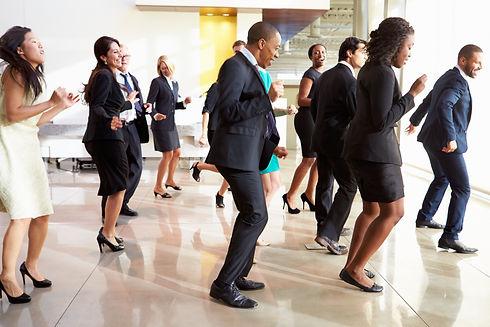 Businessmen And Businesswomen Dancing In