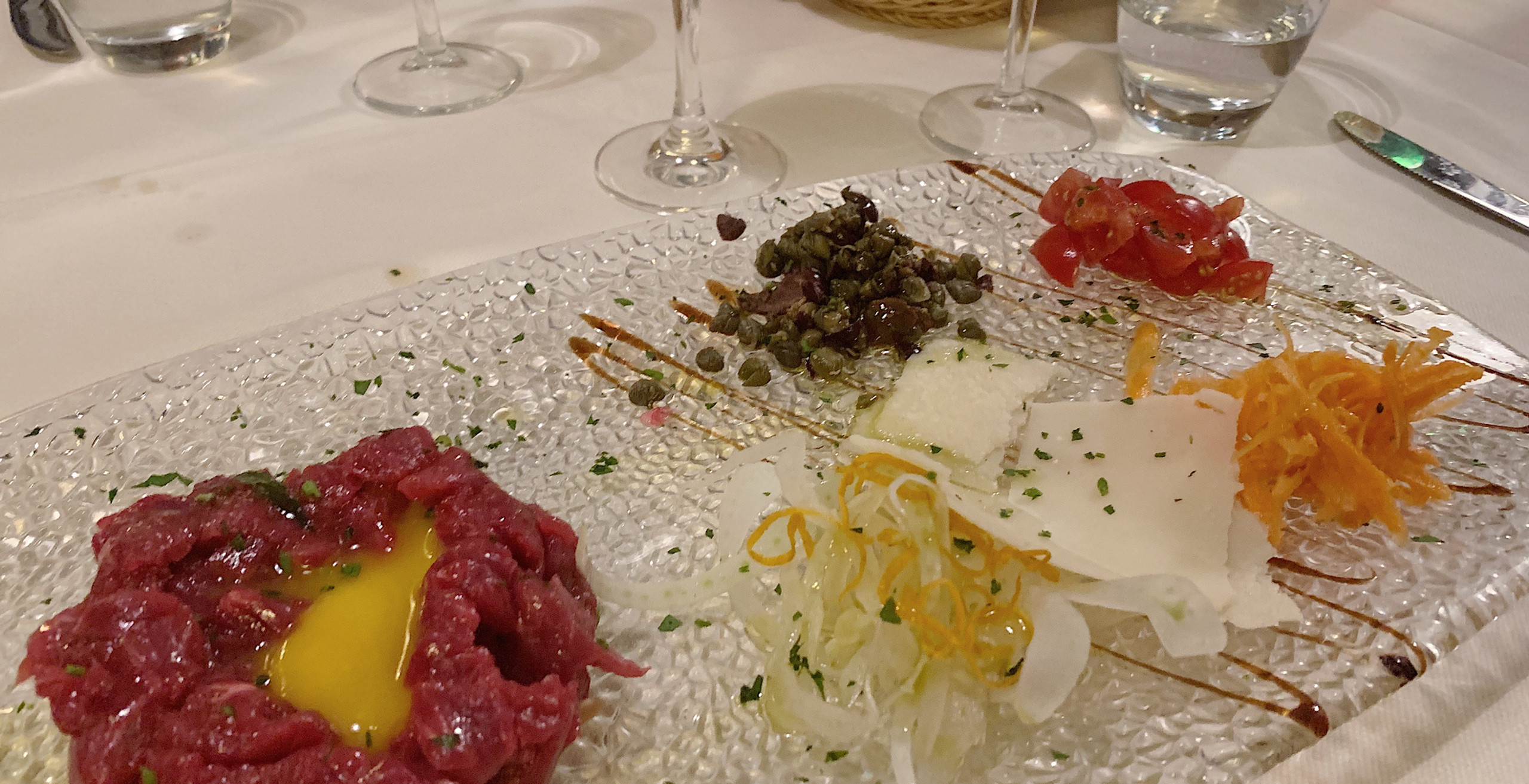 Beef Carpaccio...egg yolk for richness and your choice of !ccompaniments.  I go with capers@