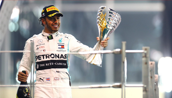 HAMILTON COMES OUT ON TOP IN ABU DHABI