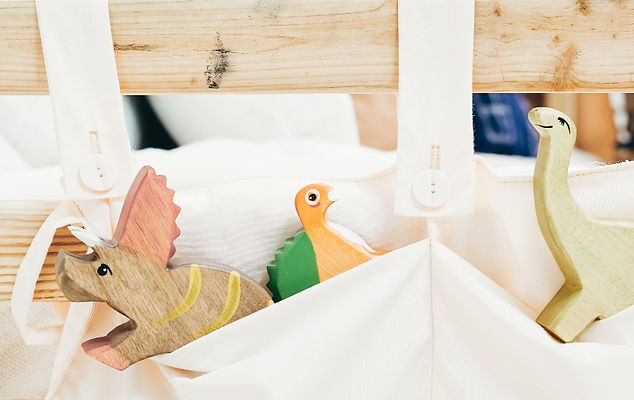 white-cloth-bag-with-brown-wooden-toy-fi