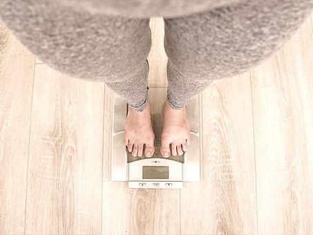 person standing on digital bathroom scale_edited.jpg