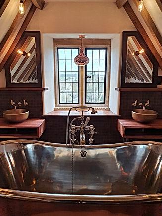 Bespoke copper bath and brass basin installation