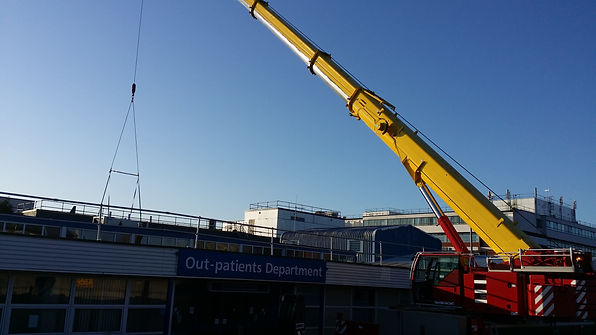 Crane placing roof mounted chiller at Kettering General Hospital