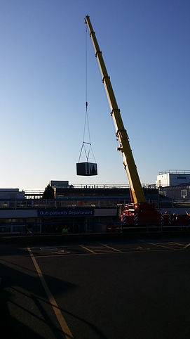 Crane placing a roof mounted chiller