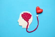 Figure of man with brain and red heart.
