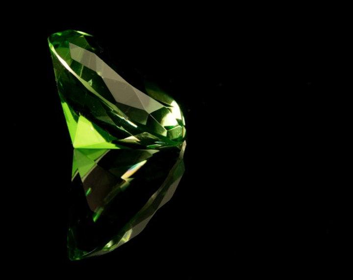 depositphotos_11300469-stock-photo-emeral-green-round-gemstone_edited.jpg
