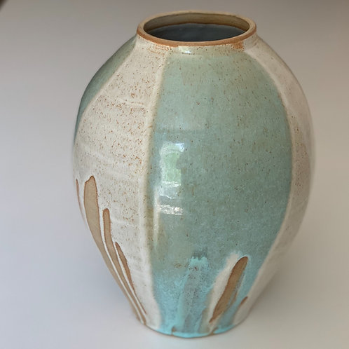 Pale blue and white vessel