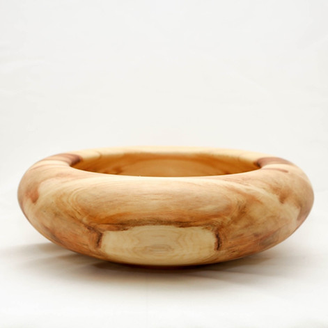 A round-rim bowl made from Aspen.