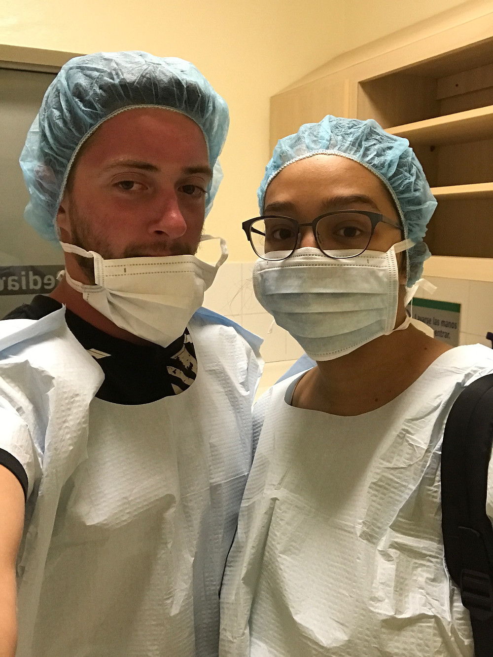 Cameron and Olivia wearing scrubs in the PICU antechamber