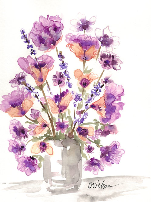 Purple and peach flowers in a vase