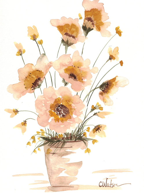 A vase of yellow flowers