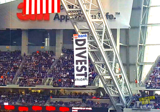 #NoDAPL Divest in US Bank banner drop at NFL game