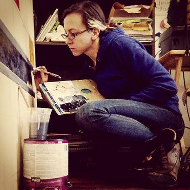 Meg Lemieur painting a mural