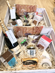 Contents: Champagne Rebeccas Chocs (x12) Rebecca's Mint Sticks Wallow Biltong Wallow Charcuterie Board Rocquette's Chutney Millers Harvest Crackers Torteval Cheese Golden Gsy Goat Cheese Mrs Fisken's Pate