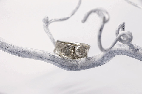 Reticulated sterling ring with fused silver balls. 6 grams