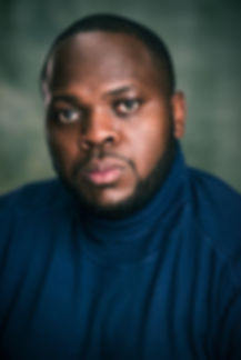 Moses Ssebandeke Headshot 1.jpg