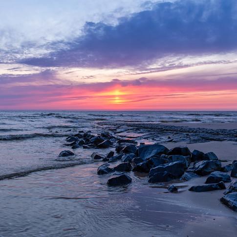 Zonsondergang aan de kust