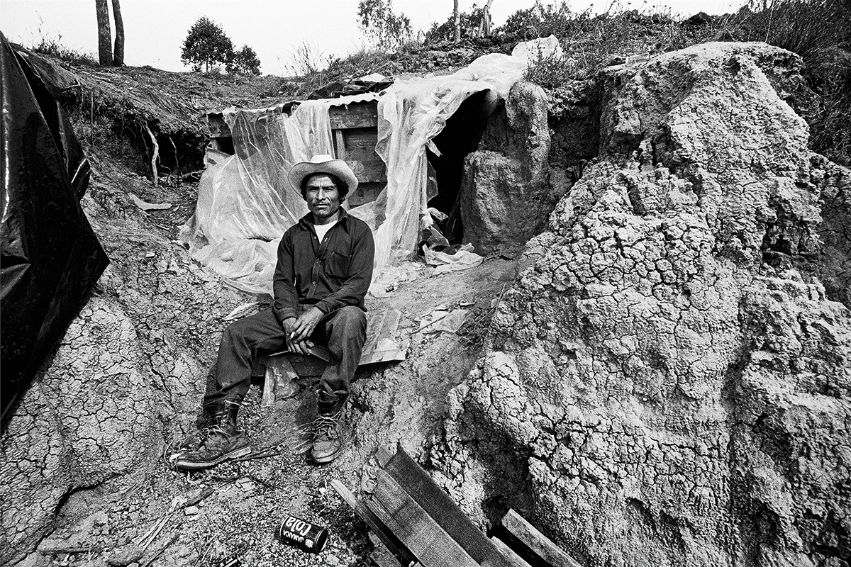 Fieldworker & Dug Out Dwelling, 1979