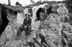 Fieldworker & Dug Out Dwelling, 1979