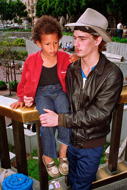 Young Man with Boy on Market St, 1986