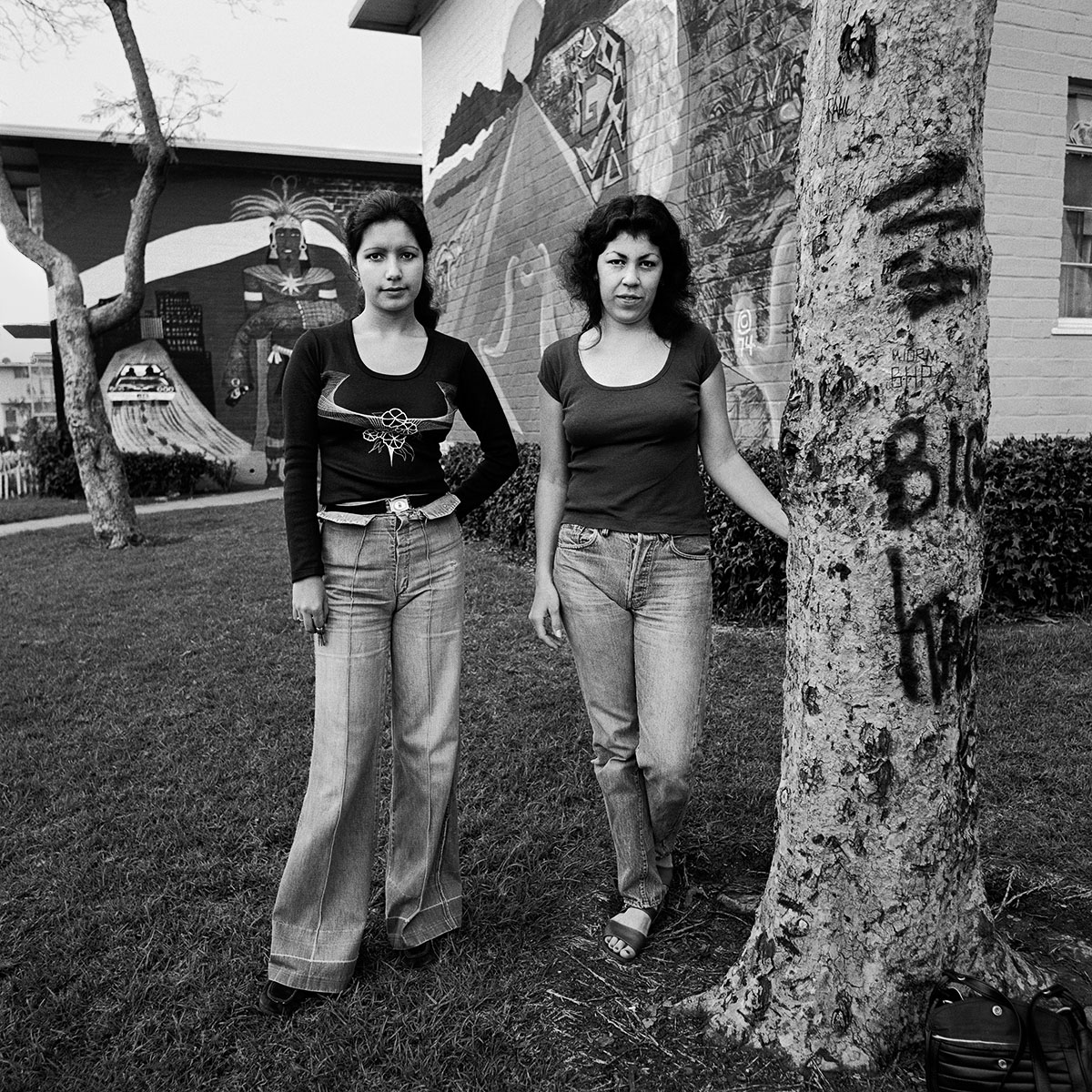 Two Young Women Next to Tree, East Los Angeles, 1978