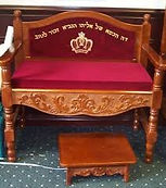 A special chair is prepared at every bris in honor of Eliyohu HaNavi, Elijah the Prophet, which is located to the right of the sandek.