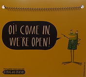 The Little Apple Bookshop Open for Business door sign