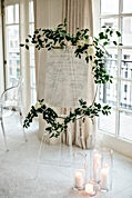 Elegant wedding sign idea with greenery
