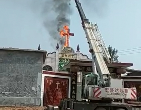 crosses in china being burned