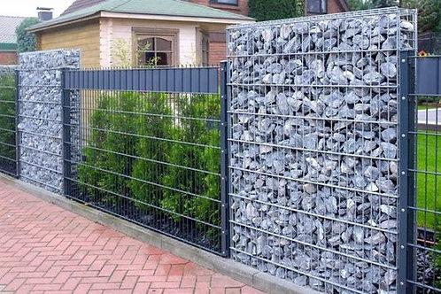 Muros de cerramiento y fachada en piedra gavionada