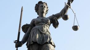 Justiça. Em defesa de quem? para quem?