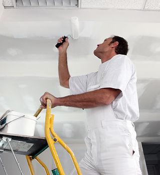 man painting ceiling.jpeg