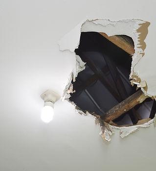 drywall repair hole.jpeg