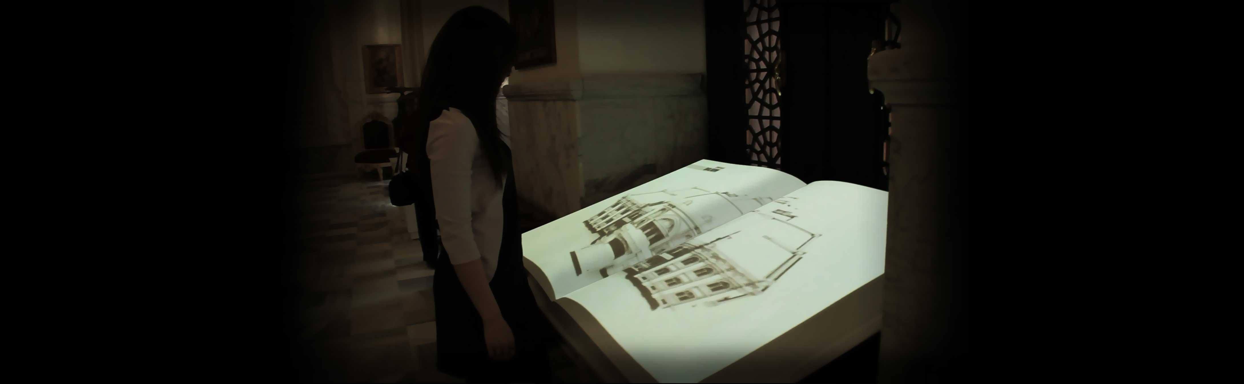 Woman looking at Interactive Book