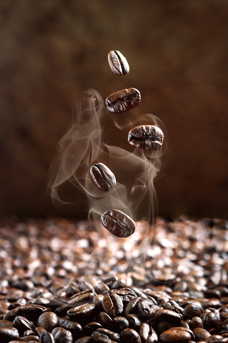 close-up-of-falling-steaming-coffee-beans-9UKW6JM.jpg
