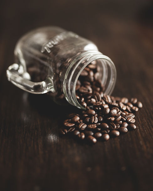 coffee-beans-spilling-out-of-a-mason-jar-AS4QSSD.jpg