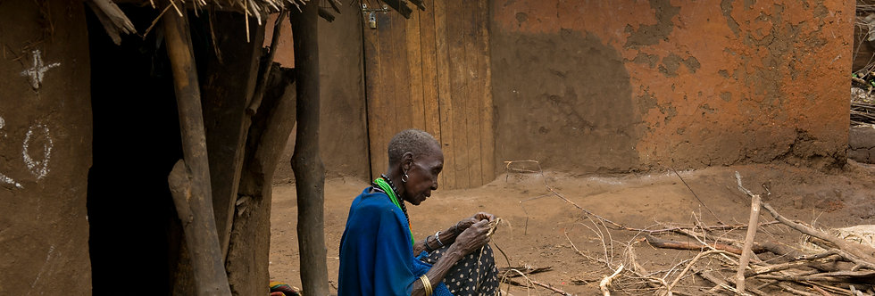 Karamajong Women Builds her Home