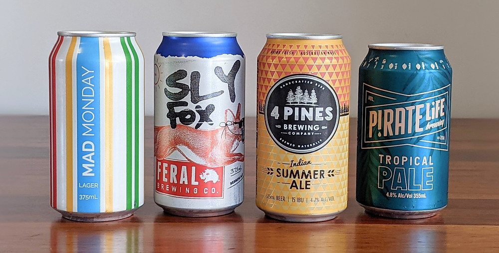 mad monday lager can, sly fox session ale can, 4 pines indian summer ale and and pirate life brewing tropical pal can