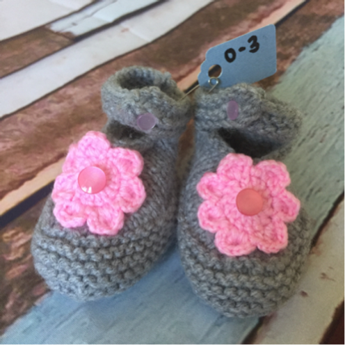 Grey crochet booties with light pink flower