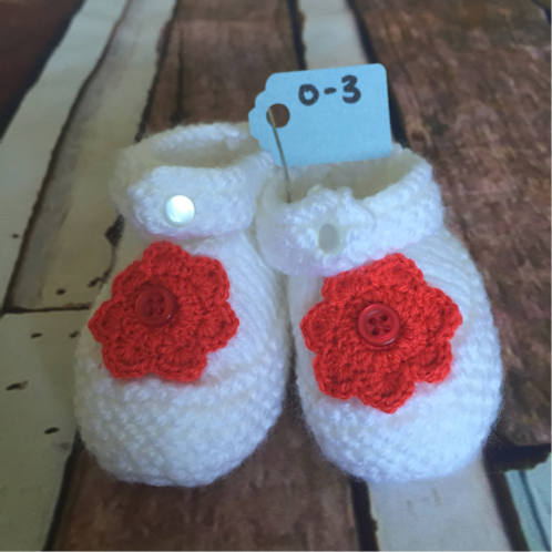 White crochet booties with red flower